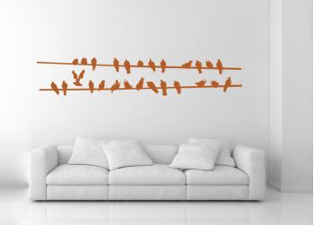 Πουλιά πάνω σε σύρμα